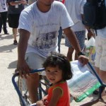 A villager of Valle Verde and his daughter pose for a photo during the CFACT-CEI-CORE food donation to the village of Valle Verde.