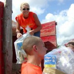 CFACT collegiates pass out food during the CFACT-CEI-CORE food donation to the village of Valle Verde. Purchased at local markets, the food probably included genetically engineered corn -- the same corn Americans have been eating for years.