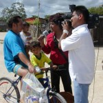 A Valle Verde villager is interviewed by a television crew during CFACT's food donation to the village of Valle Verde. The impoverished villagers were excited to receive two tons of food, and join in an economic development partnership with CFACT, CEI, and CORE.