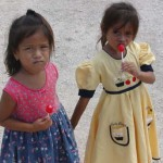 Two little girls of the village of Valle Verde clutch lollipops during the CFACT-CEI-CORE food donation to the village of Valle Verde. The candy was part of packages that included corn meal, beans, pasta and other items.